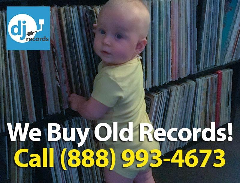 baby in front of vinyl records